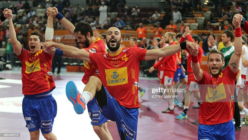 Spain's <a gi-track='captionPersonalityLinkClicked' href=/galleries/search?phrase=Albert+Rocas&family=editorial&specificpeople=855149 ng-click='$event.stopPropagation()'>Albert Rocas</a> (C) celebrates thier win during the 24th Men's Handball World Championships quarterfinals match between Denmark and Spain at the Lusail Multipurpose Hall in Doha on January 28, 2015.