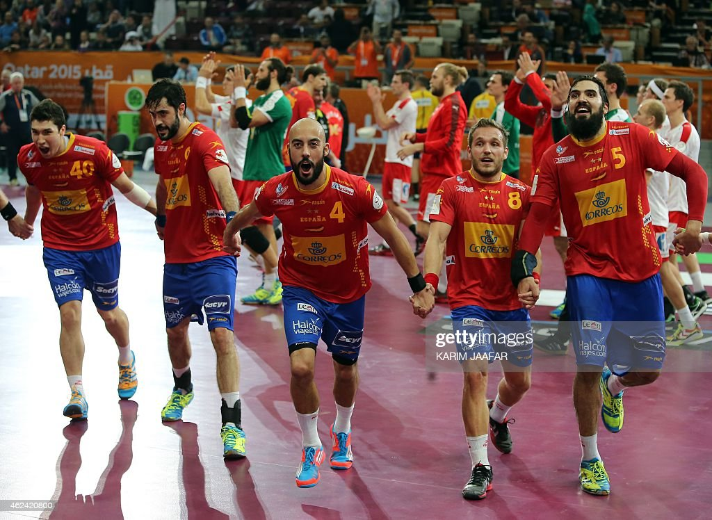 Spain's <a gi-track='captionPersonalityLinkClicked' href=/galleries/search?phrase=Albert+Rocas&family=editorial&specificpeople=855149 ng-click='$event.stopPropagation()'>Albert Rocas</a> (C) celebrates thier win with team mates during the 24th Men's Handball World Championships quarterfinals match between Denmark and Spain at the Lusail Multipurpose Hall in Doha on January 28, 2015.