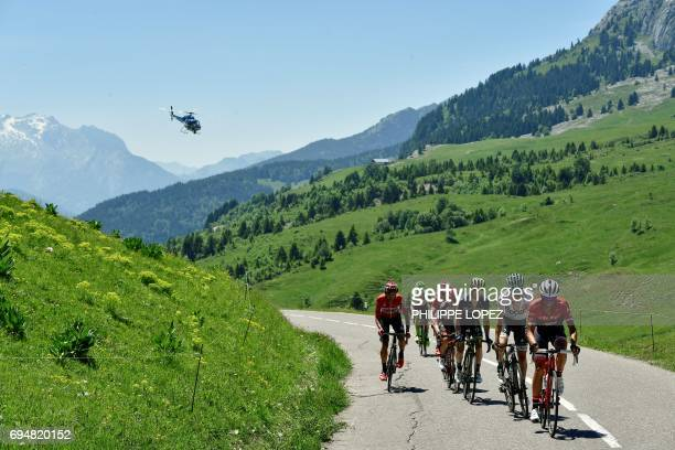 Spain's Alberto Contador and Germany's Emanuel Buchmann wearing the best young's white jersey ride in a breakaway as a media helicopter flies over...