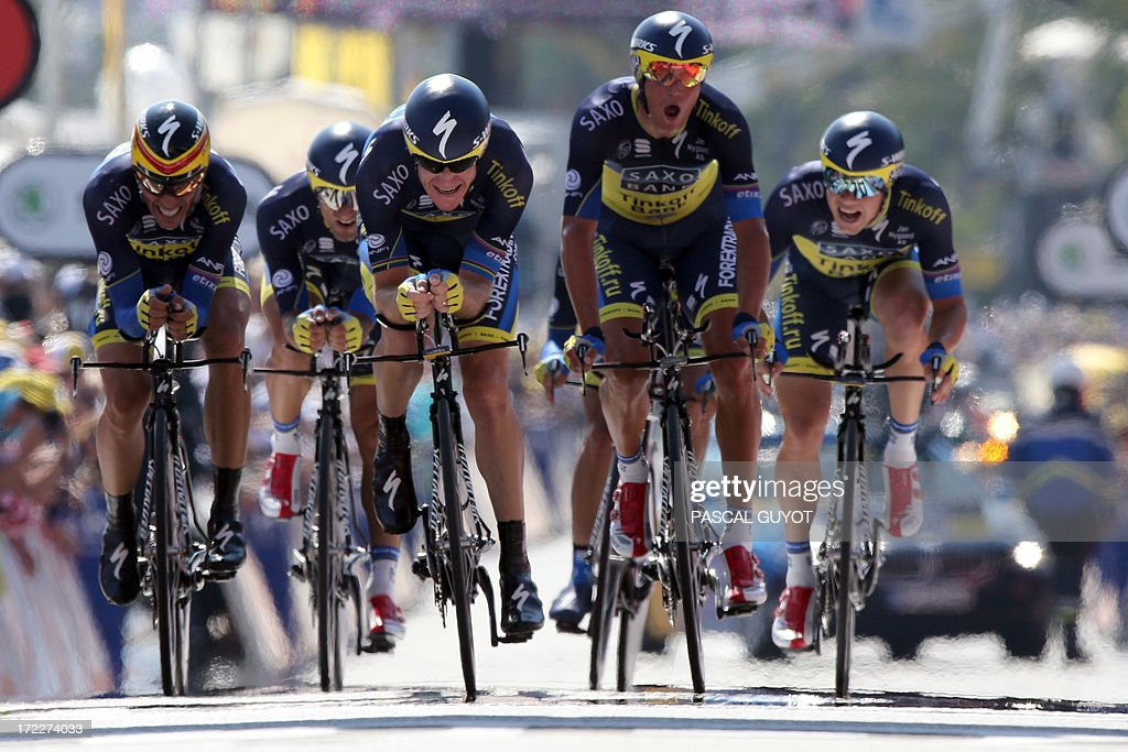 Spain's Alberto Contador (L) and his Saxo-Tinkoff teammates cross the finish line at the end of the 25 km team time-trial and fourth stage of the 100th edition of the Tour de France cycling race on July 2, 2013 around Nice, southeastern France.