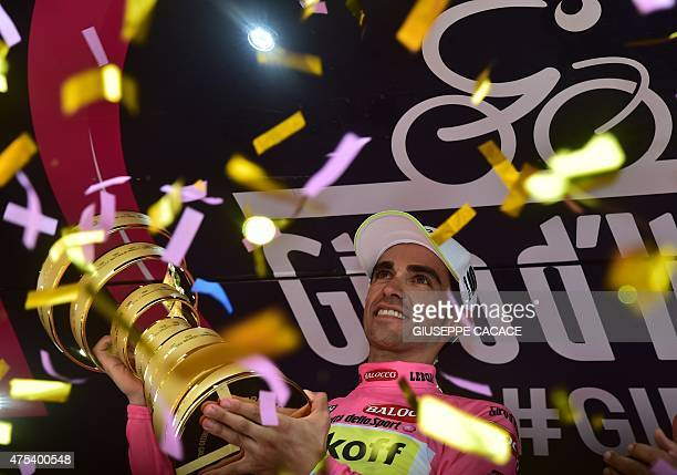 Spain's Alberto Contador celebrates with his trophy on the podium after winning the 98th Giro d'Italia Tour of Italy cycling race in Milan on May 31...