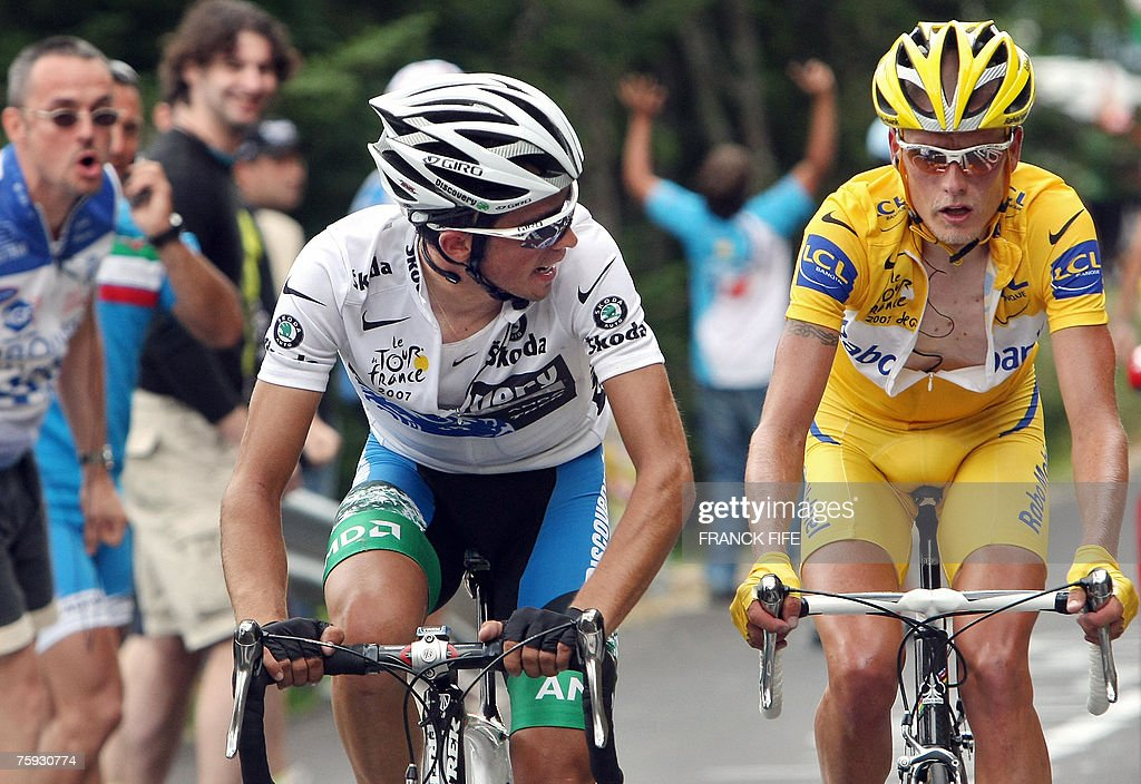 spains-alberto-contador-checks-on-yellow-jersey-denmarks-michael-picture-id75930774