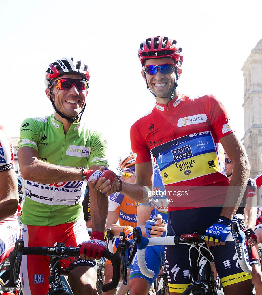 Spain's Alberto Contador (R) of the Saxo Bank-Tinkoff Bank Team and Spanish cyclist Joaquim Rodriguez of Katusha team shake hands before the start of the eighteenth stage of the Vuelta tour of Spain, a 204,5 kms ride from Aguilar de Campoo to Valladolid, on September 6, 2012. AFP PHOTO/ Jaime REINA