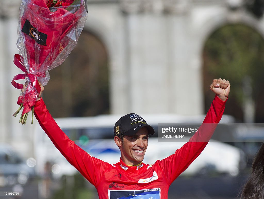 Spain's Alberto Contador of the Saxo Bank-Tinkoff Bank Team celebrates on the podium after winning the Vuelta cycling Tour of Spain in Madrid, on September 9, 2012. Spain's Alberto Contador, racing his first Grand Tour since returning from a two-year doping ban last month, won his second Tour of Spain crown.AFP PHOTO/ Jaime REINA
