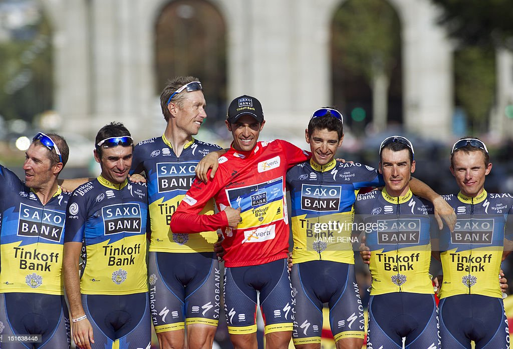 Spain's Alberto Contador (C) of the Saxo Bank-Tinkoff Bank Team celebrates with his teammates on the podium after winning the Vuelta cycling Tour of Spain in Madrid, on September 9, 2012. Spain's Alberto Contador, racing his first Grand Tour since returning from a two-year doping ban last month, won his second Tour of Spain crown, Spain's Alejandro Valverde of the Movistar team was second and compatriot Joaquim Rodriguez of Katusha team third . AFP PHOTO/ Jaime REINA