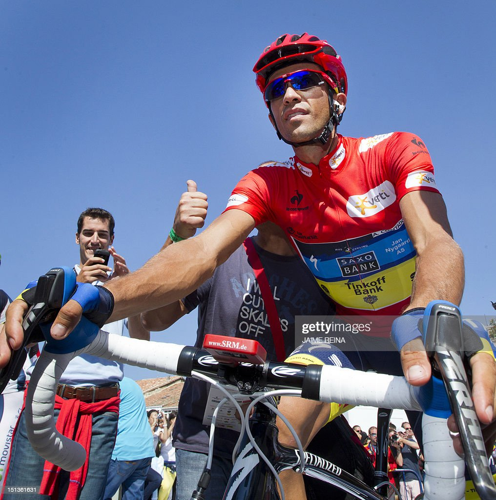Spain's Alberto Contador of the Saxo Bank-Tinkoff Bank Team looks on before the start of the eighteenth stage of the Vuelta tour of Spain, a 204,5 kms ride from Aguilar de Campoo to Valladolid, on September 6, 2012. AFP PHOTO / Jaime REINA