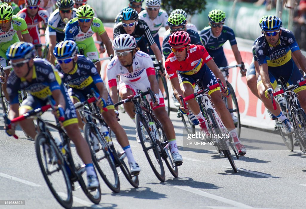 Spain's Alberto Contador (C) of the Saxo Bank-Tinkoff Bank Team rides with the pack during the last stage of the Vuelta tour of Spain, a 115 kms ride from Cercedilla to Madrid, on September 9, 2012. Spain's Alberto Contador, racing his first Grand Tour since returning from a two-year doping ban last month, won his second Tour of Spain crown, Valverde was second and Rodriguez third. AFP PHOTO/ Jaime REINA
