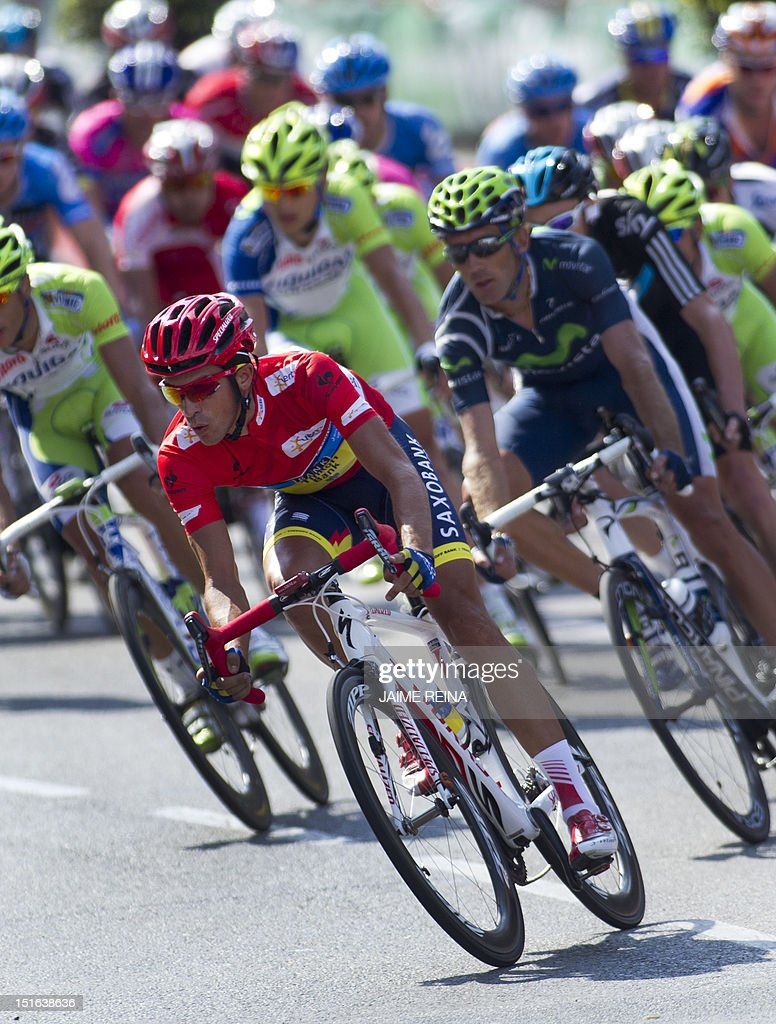 Spain's Alberto Contador (L) of the Saxo Bank-Tinkoff Bank Team rides with the pack during the last stage of the Vuelta tour of Spain, a 115 kms ride from Cercedilla to Madrid, on September 9, 2012. Spain's Alberto Contador, racing his first Grand Tour since returning from a two-year doping ban last month, won his second Tour of Spain crown, Valverde was second and Rodriguez third. AFP PHOTO/ Jaime REINA