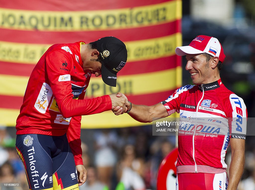 Spain's Alberto Contador (L) of the Saxo Bank-Tinkoff Bank Team shakes hands with compatriot Joaquim Rodriguez of Katusha team (R) on the podium after the Vuelta cycling Tour of Spain in Madrid, on September 9, 2012. Spain's Alberto Contador, racing his first Grand Tour since returning from a two-year doping ban last month, won his second Tour of Spain crown, Spain's Alejandro Valverde of the Movistar team was second and Rodriguez third. AFP PHOTO/ Jaime REINA