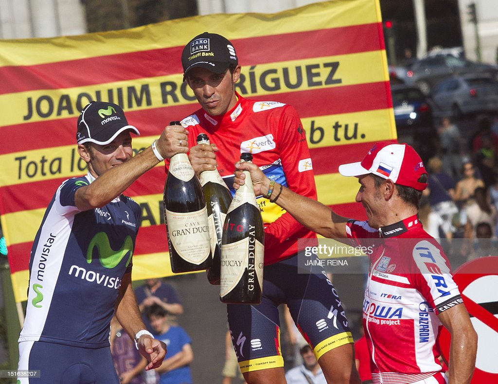 Spain's Alberto Contador (C) of the Saxo Bank-Tinkoff Bank Team, Spain's Alejandro Valverde (L) of the Movistar team and compatriot Joaquim Rodriguez of Katusha team (R) celebrate on the podium after the Vuelta cycling Tour of Spain in Madrid, on September 9, 2012. Spain's Alberto Contador, racing his first Grand Tour since returning from a two-year doping ban last month, won his second Tour of Spain crown, Valverde was second and Rodriguez third. AFP PHOTO/ Jaime REINA