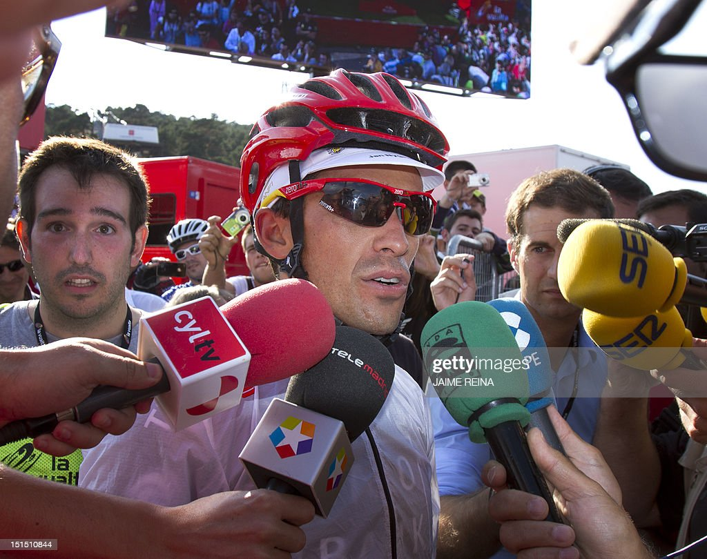 Spain's Alberto Contador of the Saxo Bank-Tinkoff Bank Team talks to the press during the 20th stage of the Vuelta tour of Spain, a 170,7 kms ride from La Faisanera golf to Bola del Mundo, on September 8, 2012 in Navacerrada. Russia's Denis Menchov of the Katusha team won the 20th and penultimate stage of the Tour of Spain with Spain's Alberto Contador retaining the overall lead. AFP PHOTO/ Jaime REINA