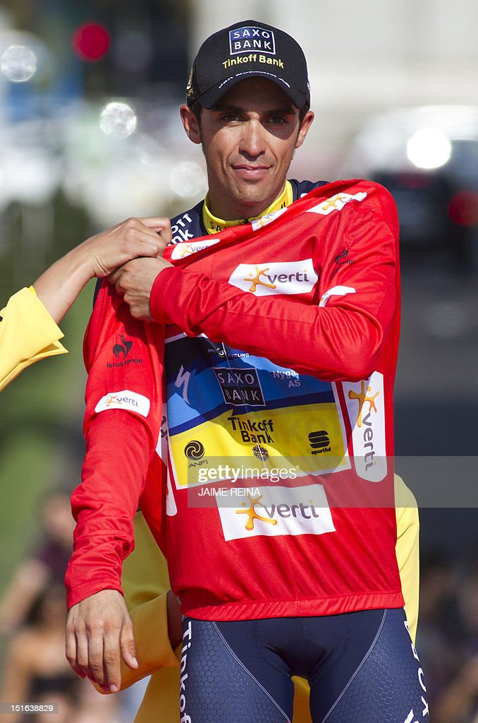 Spain's Alberto Contador of the Saxo Bank-Tinkoff Bank Team wears the leader's red jersey on the podium of the Vuelta cycling Tour of Spain in Madrid, on September 9, 2012. Spain's Alberto Contador, racing his first Grand Tour since returning from a two-year doping ban last month, won his second Tour of Spain crown, Spain's Alejandro Valverde of the Movistar team was second and compatriot Joaquim Rodriguez of Katusha team third . AFP PHOTO / Jaime REINA