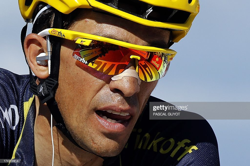 Spain's Alberto Contador reacts after crossing the finish line at the end of the 125 km twentieth stage of the 100th edition of the Tour de France cycling race on July 20, 2013 between Annecy and Annecy-Semnoz, French Alps. AFP PHOTO / PASCAL GUYOT
