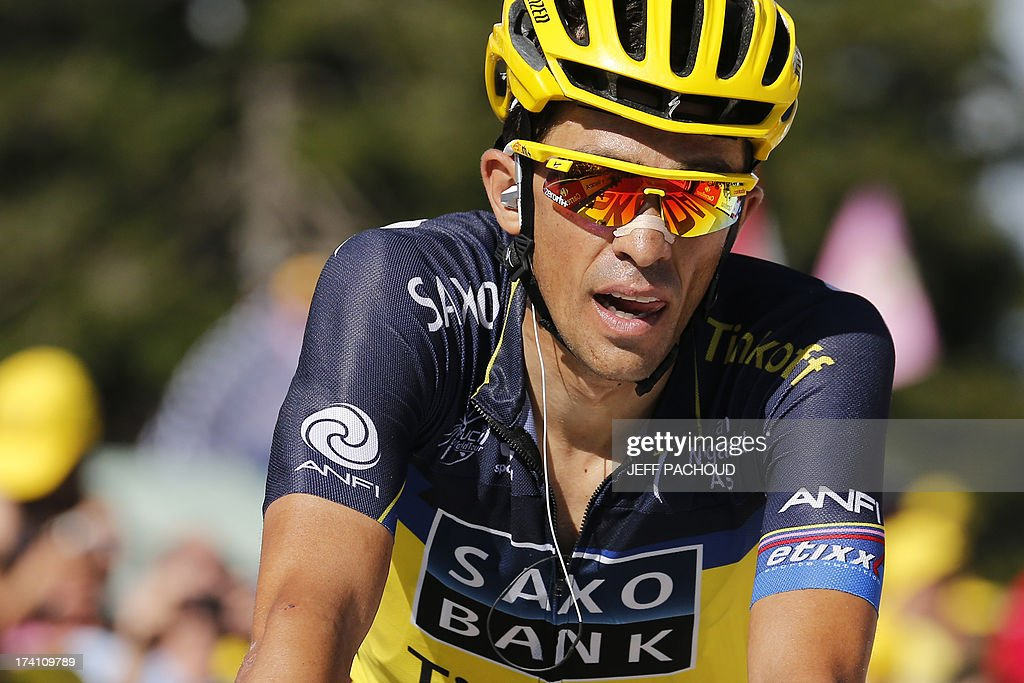 Spain's Alberto Contador reacts as he crosses the finish line at the end of the 125 km twentieth stage of the 100th edition of the Tour de France cycling race on July 20, 2013 between Annecy and Annecy-Semnoz, French Alps.