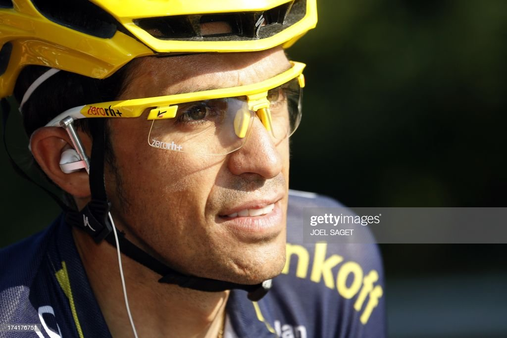 Spain's Alberto Contador rides at the start of the 133.5 km twenty-first and last stage of the 100th edition of the Tour de France cycling race on July 21, 2013 between Versailles and Paris