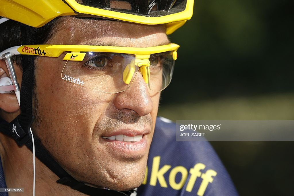Spain's Alberto Contador rides at the start of the 133.5 km twenty-first and last stage of the 100th edition of the Tour de France cycling race on July 21, 2013 between Versailles and Paris AFP PHOTO / JOEL SAGET