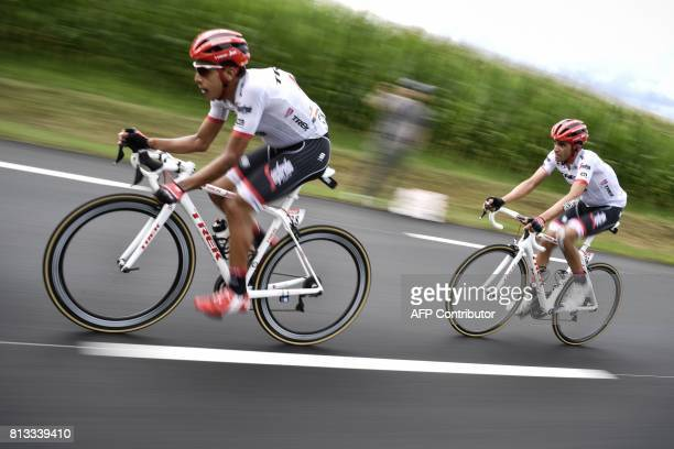 Spain's Alberto Contador rides behind his teammate Colombia's Jarlinson Pantano as he restarts after falling during the 2035km eleventh stage of the...