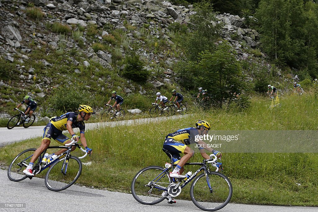 Spain's Alberto Contador (R) rides during the 204.5 km nineteenth stage of the 100th edition of the Tour de France cycling race on July 19, 2013 between Bourg-d'Oisans and Le Grand-Bornand, French Alps. AFP PHOTO / JOEL SAGET