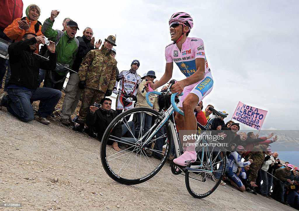 Spain's Alberto Contador rides on the pedals to finish fourth his individual up hill time trial of the 16th stage of the 91st Giro d'Italia from San...