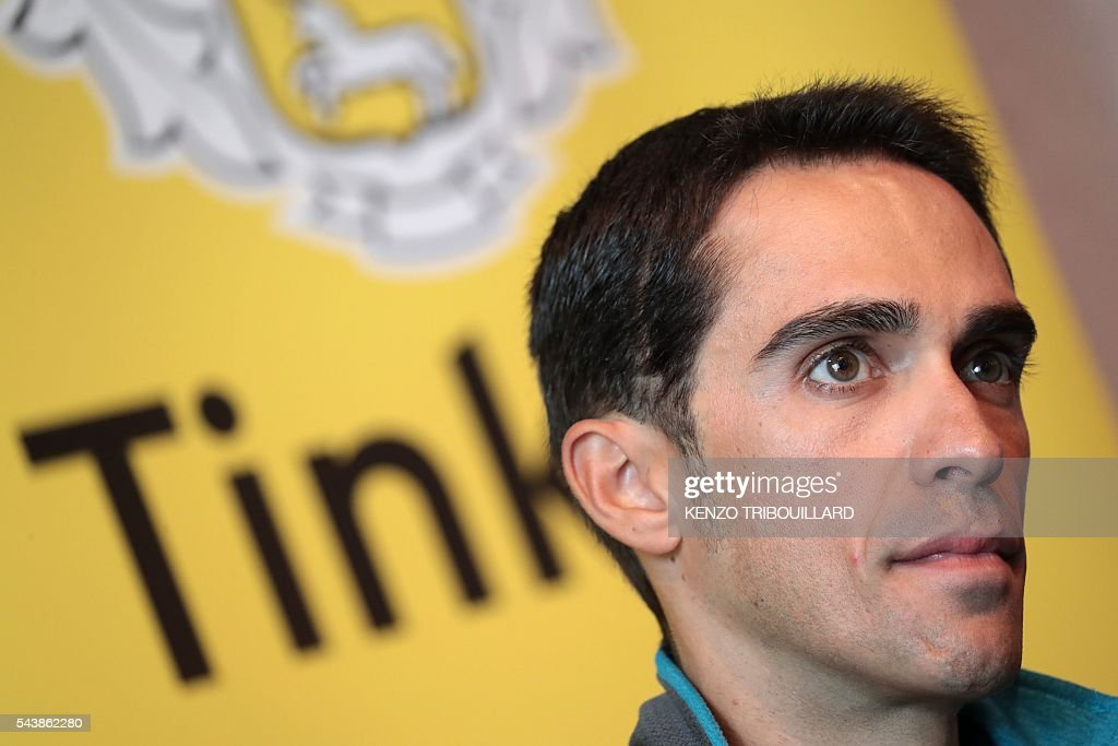 Spain's Alberto Contador takes part in a press conference of the Russia's Tinkoff cycling team in Coutances, Normandy, on July 30, 2016, two days before the start of the 103rd edition of the Tour de France cycling race. The 2016 Tour de France will start on July 2 in the streets of Le Mont-Saint-Michel and ends on July 24, 2016 down the Champs-Elysees in Paris. / AFP / KENZO