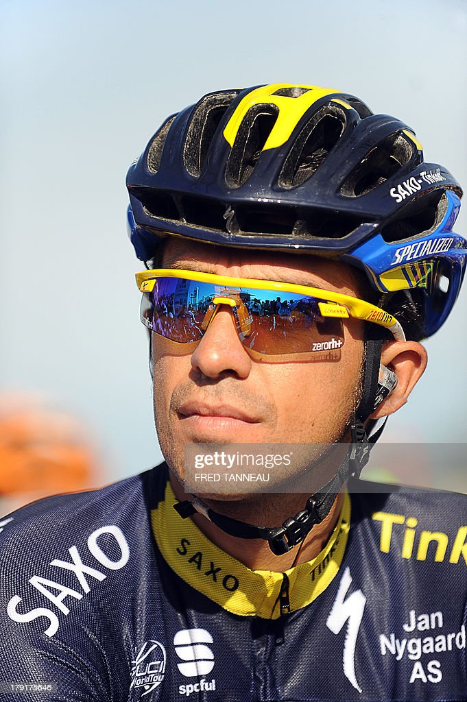 Spain's Alberto Contador waits for the start of the 77th edition of the Plouay Grand Prix cycling race on September 1, 2013 in Plouay, western of France. This year, 238 cyclists compete in the Plouay Grand Prix cycling race. AFP PHOTO / FRED TANNEAU