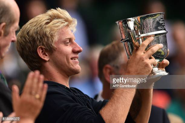 Spain's Alejandro Davidovich Fokina holds his winner's trophy after winnning his boys' singles final match against Argentina's Axel Geller on the...