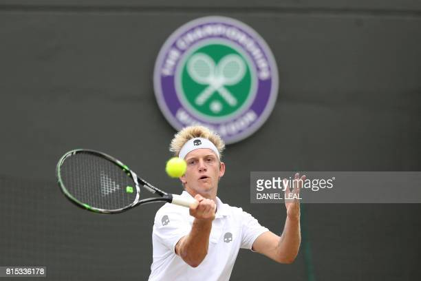 Spain's Alejandro Davidovich Fokina returns against Argentina's Axel Geller during their boys' singles final match on the last day of the 2017...