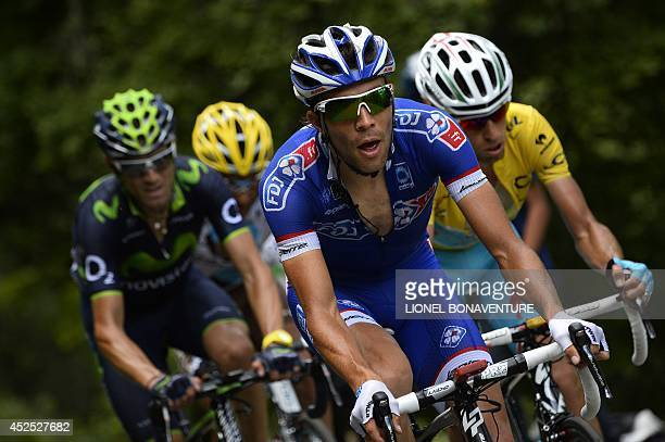 Spain's Alejandro Valverde France's Thibaut Pinot and Italy's Vincenzo Nibali wearing the overall leader's yellow jersey ride in the pack during the...