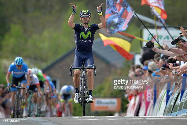 Spain's Alejandro Valverde of Movistar Team gestures as he celebrates winning the 78th edition of the 'La Fleche Wallonne' cycling race 199km from...