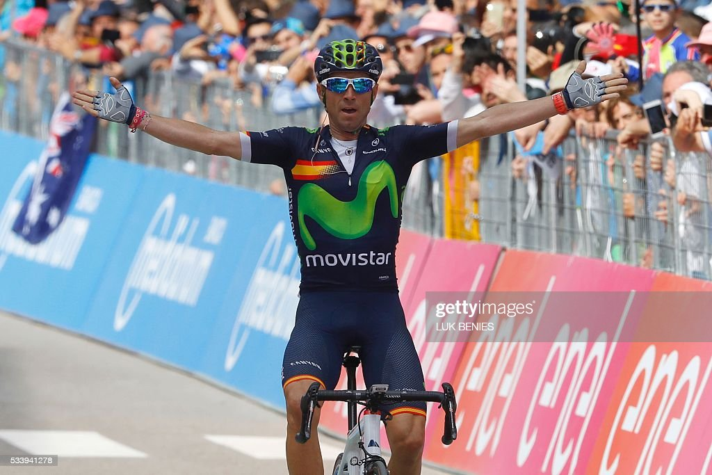 Spain's Alejandro Valverde of team Movistar celebrates as he crosses the finish line to win the 16th stage of the 99th Giro d'Italia, Tour of Italy, from Bressanone / Brixen to Andalo on May 24, 2016. / AFP / VINCENZO