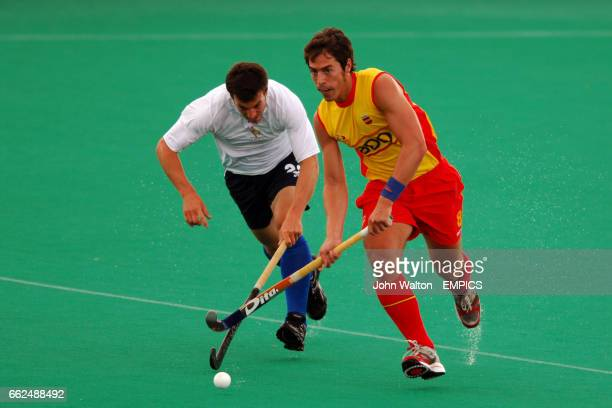 Spain's Alex Fabregas and France's Antoine Gouedard Comte battle for the ball