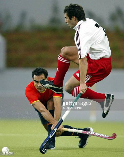 Spain's Alex Fabregas vies with Britain's Niall Stott during an Olympic test event at the Hellinikon Olympic Hockey Center in Athens 04 February 2004...