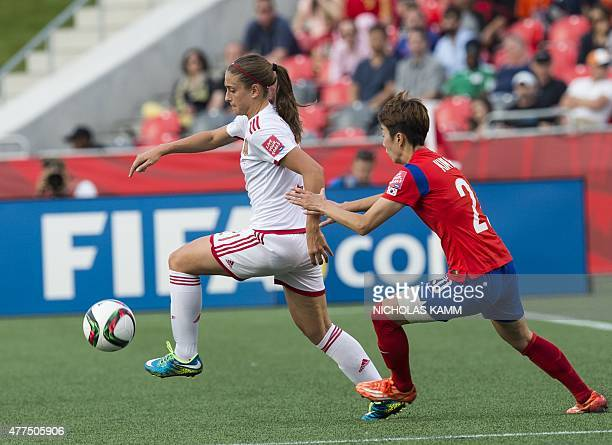 Spain's Alexia Putellas and South Korea's Kim Hyeri fight for the ball during a 2015 FIFA Women's World Cup Group E football match at Lansdowne...
