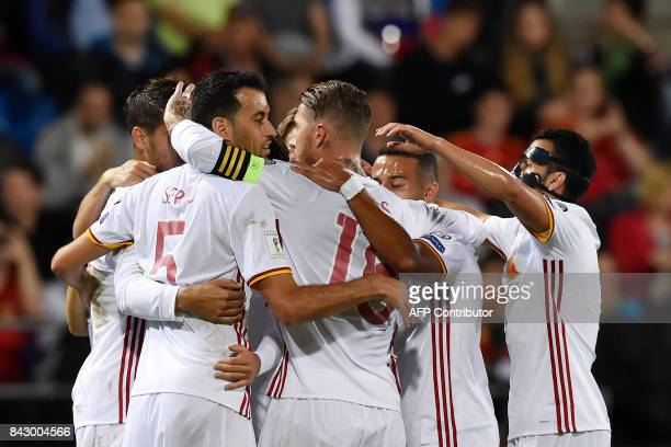 Spain's Alvaro Morata is congratulated by teammates after scoring a goal during the FIFA World Cup 2018 qualification football match between...