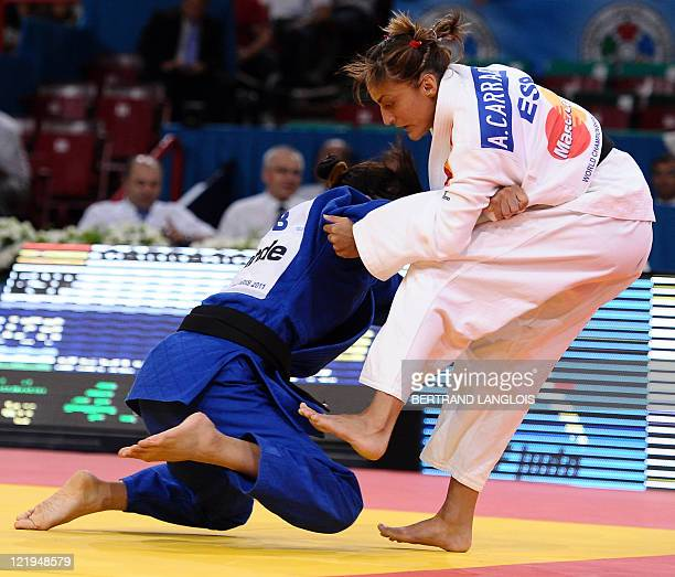 Spain's Ana Carrascosa fights against Uzbekistan's Rima Berdygulova during their qualifier match in the 52kg category at the Judo World Championships...