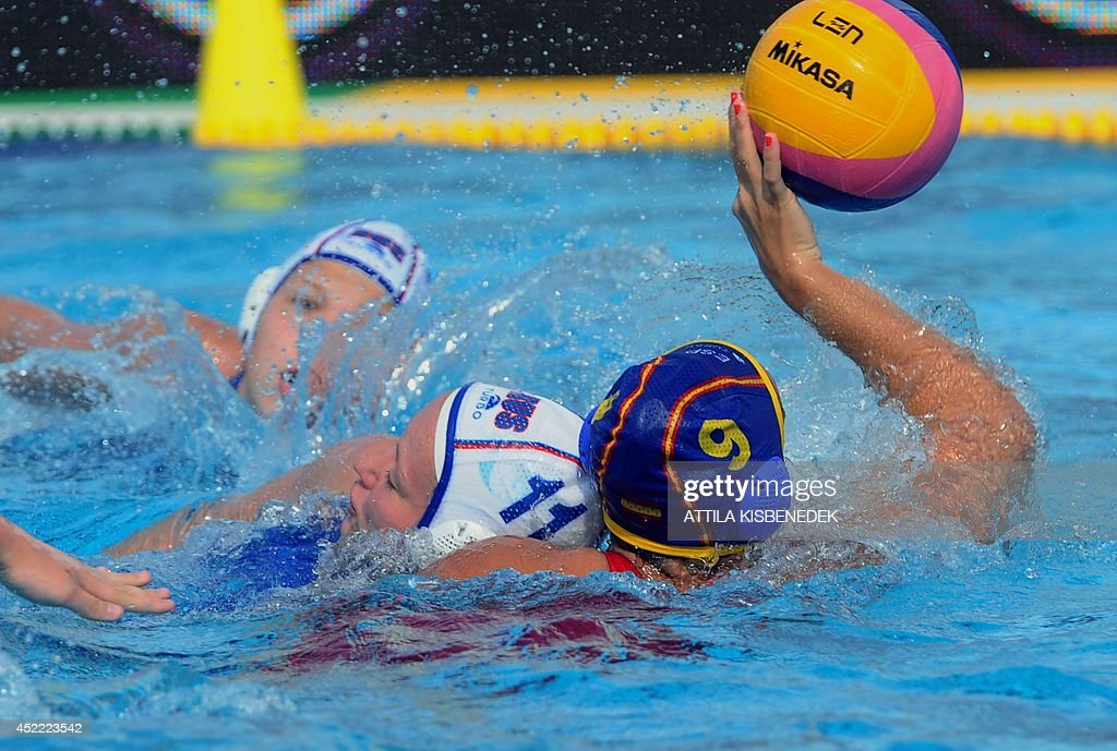 Spain's Andrea Blas fights for the ball with Russia's Evgeniya Ivanova during the Water Polo European Championships match for women between Spain and...