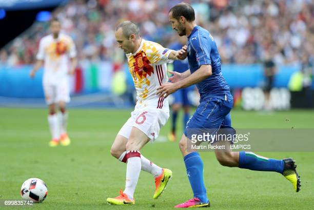 Spain's Andres Iniesta and Italy's Giorgio Chiellini battle for the ball