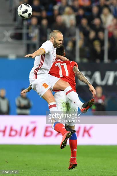 Spain's Andres Iniesta and Russia's Fedor Smolov vie for the ball during an international friendly football match between Russia and Spain at the...