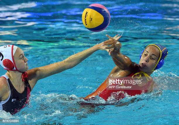 Spain's Anna Espar Llaquet fights for the ball with Canada's Hayley McKelvey during the semifinal water polo match between Canada and Spain at the...