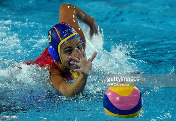 Spain's Anna Espar Llaquet prepares to grab the ball during the semifinal water polo match between Canada and Spain at the 2017 FINA World...