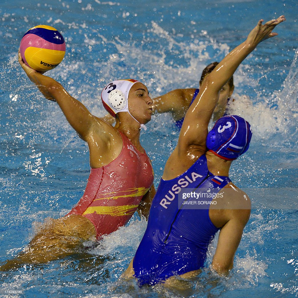 Spain's Anna Espar (L) vies with Russia's Ekaterina Prokofyeva (R) during the preliminary round match between Spain and Russia in the women's water polo competition at the FINA World Championships in Bernat Picornell pools in Barcelona on July 23, 2013.