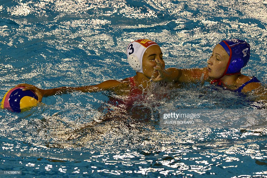 Spain's Anna Espar (L) vies with Russia's Elvina Karimova (R) during the preliminary round match between Spain and Russia in the women's water polo competition at the FINA World Championships in Bernat Picornell pools in Barcelona on July 23, 2013. AFP PHOTO / JAVIER SORIANO