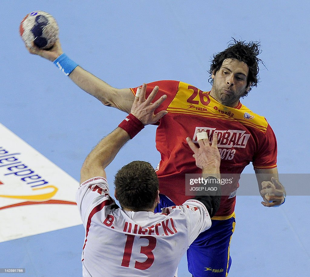 Spain's Antonio Jesus Garcia Robledo (up) vies with Poland's Bartosz Jurecki (down) during the handball pre-Olympic qualifying match Spain vs Poland on April 8, 2012 at the Tecnificacion Center sports hall in Alicante. Spain won 33-22.