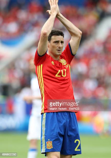 Spain's Aritz Aduriz applauds the fans after the match