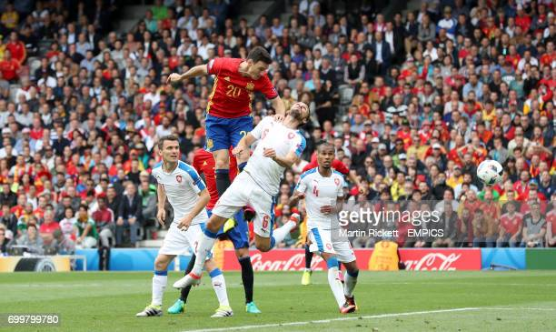Spain's Aritz Aduriz has a headed attempt on goal