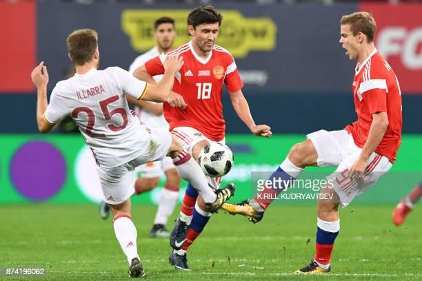 Spain's Asier Illarramendi Russia's Yury Zhirkov and Alexander Kokorin vie for the ball during an international friendly football match between...