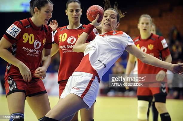 Spain's Begona Fernandez tries to score despite Montenegro's defenders during the 2012 EHF European Women's Handball Championship Group II main round...