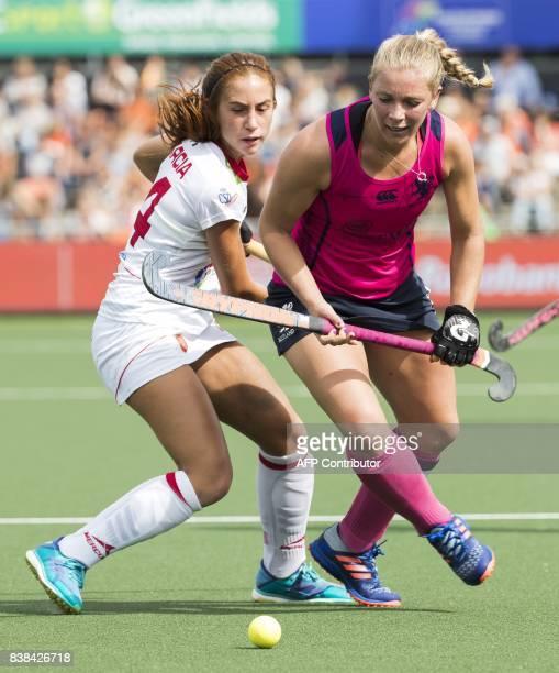 Spain's Begona Garcia vies with Scotland's Kareena Cuthbert during the Women's Rabo EuroHockey Championships field hockey match between Spain and...