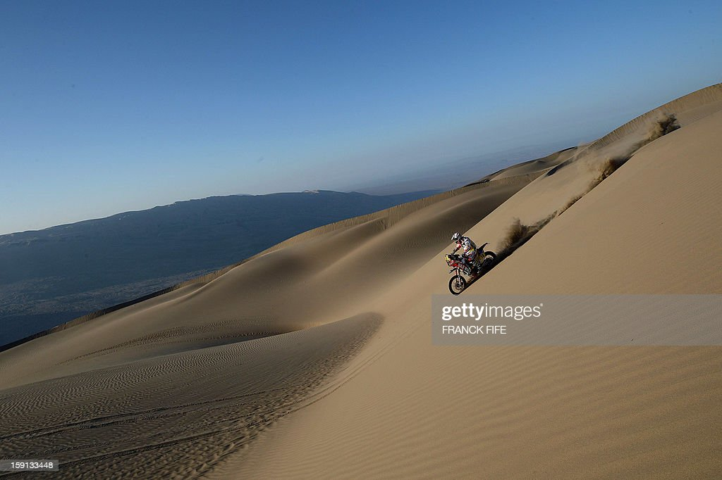 Spain's biker Gerad Farres Guell competes during Stage 4 of the Dakar 2013 between Nazca and Arequipa, Peru, on January 8, 2013. The rally will take place in Peru, Argentina and Chile from January 5 to 20. AFP PHOTO/Franck Fife