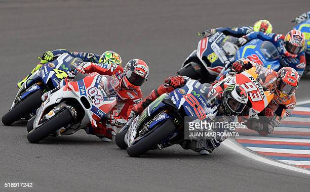 Spain's biker Jorge Lorenzo on Yamaha Italy's Andrea Dovizioso on Ducati and Spain's Marc Marquez on Honda compete during the MotoGP race of the...
